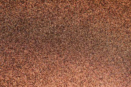 closeup of brown copper glittering background with shallow depth of field 写真素材