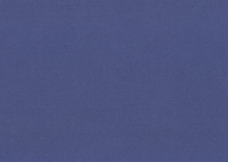 closeup of grained dark blue paper background texture
