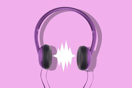 front view closeup of black and violet headphones isolated on pink background with empty comic sound speech bubble Stok Fotoğraf