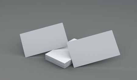 3d illustration horizontal closeup of two blank white business cards stack for mockup or template design on grey background Фото со стока