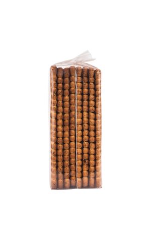 side view closeup of square shaped whole grain pack of brown biscuit in transparent plastic packaging isolated on white 版權商用圖片