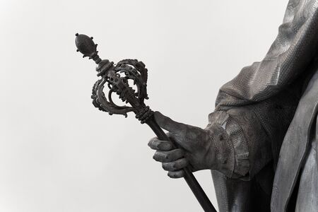 closeup of a black classical statue with hand holding an ornated large scepter Banco de Imagens