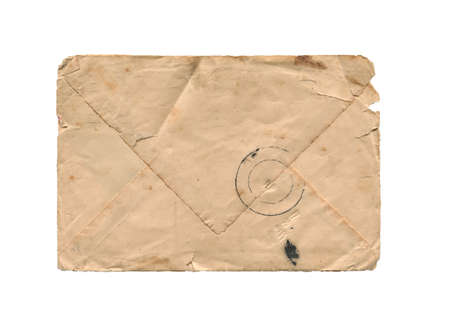 front view closeup of blank brown old aged closed letter paper envelope with torn edges antique stained texture and postal stamp isolated on white background Banque d'images