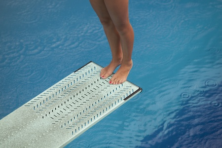 free diving: girl standing on diving board