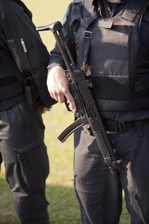 policeman with machine gun photo