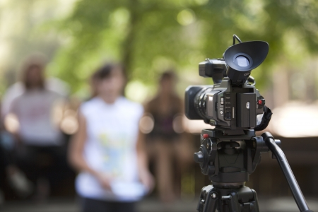 tv reporter: covering an event with a video camera Stock Photo