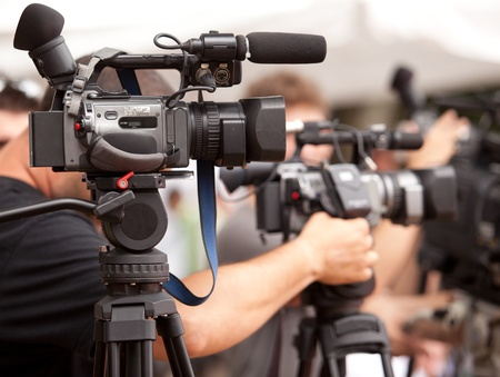newscast: covering an event with a video camera Stock Photo
