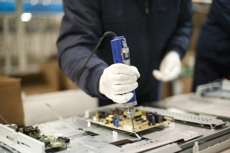 manufactura: trabajador manual Foto de archivo