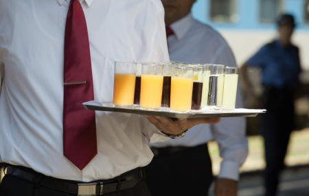 party tray: waiter serving soft drinks at a party