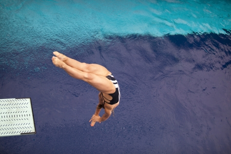 free diving: girl diving into the pool  Stock Photo