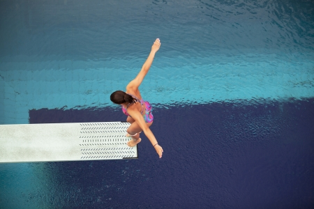 high jump: preparing to dive into a swimming pool