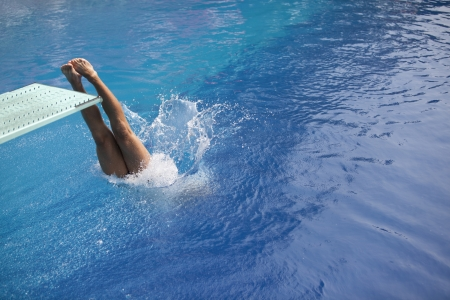 free diving: swimmer diving into a pool  Stock Photo