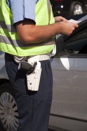police uniform: police officer doing a traffic control