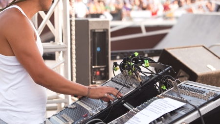 master volume: sound control engineer in outdoor concert event
