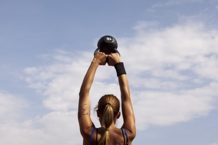 outdoor training: crossfit kettlebell swing  Stock Photo