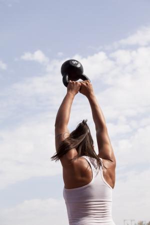 crossfit kettlebell swing  Фото со стока