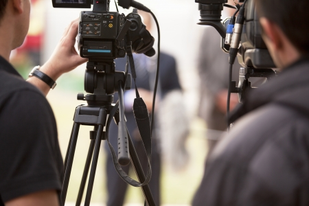 media equipment: covering an event with a video camera Stock Photo