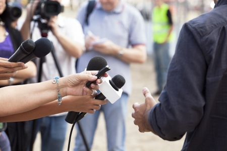 tv news: covering an event with a video camera Stock Photo
