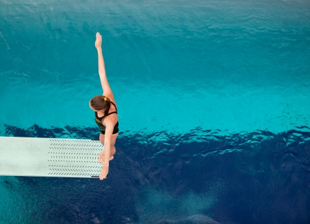 free diver: preparing to dive into a swimming pool