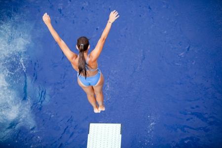 springboard diver Stock Photo