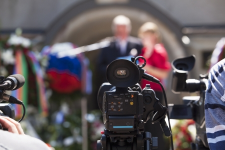 press conference: covering an event with a video camera Stock Photo