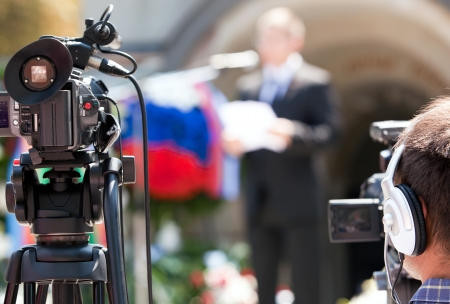 live action: covering an event with a video camera Stock Photo
