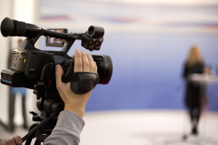 filming: covering an event with a video camera Stock Photo