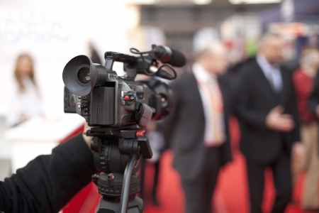 cameraman: covering an event with a video camera Stock Photo