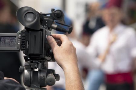 Bedeckt eine Veranstaltung mit einer Videokamera Standard-Bild - 24982384