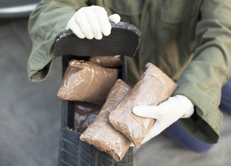 drug trafficking: drug bundles found in spare tire Stock Photo