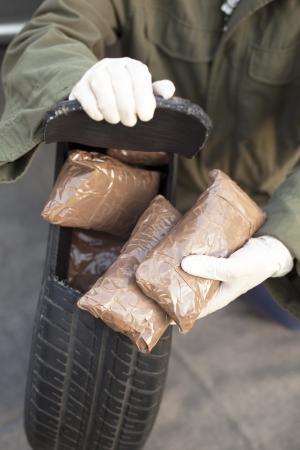 drug trafficking: drug bundles found in spare tire Stock Photo