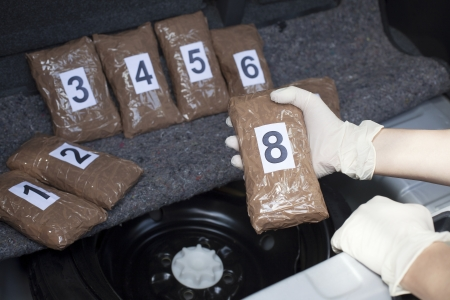 drug trafficking: drug smuggled in a car trunk Stock Photo