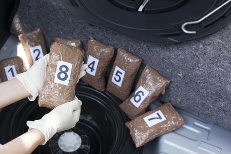 drug trafficking: drug smuggled in a car trunk Stock Photo