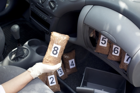 drug trafficking: hidden drugs in a vehicle compartment Stock Photo
