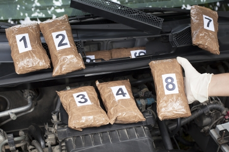 engine compartment: drug smuggled in a car s engine compartment Stock Photo