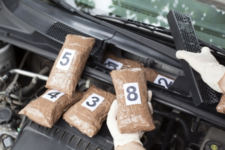 drug trafficking: drug smuggled in a car s engine compartment Stock Photo