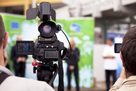 covering an event with a video camera Фото со стока