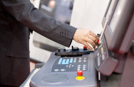 experienced operator: man working at programmable machine Stock Photo