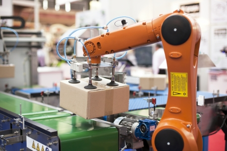 robotic: robotic arm for packing Stock Photo