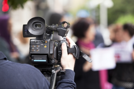 covering a street protest using video camera photo