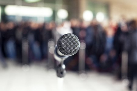 focus group: microphone in focus against blurred audience