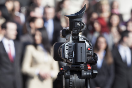 press conference: capturing event with professional video camera