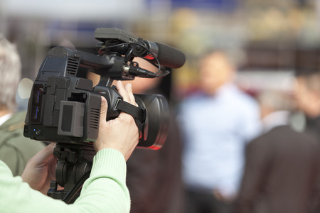 people  camera: covering an event with a video camera Stock Photo