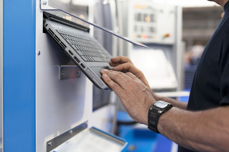 Man working at a programmable machine Stock Photo