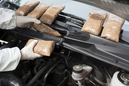 drug trafficking: Hidden drugs in a vehicle compartment