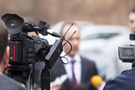 Couvrir avec un événement d'une caméra vidéo. conférence de Nouvelles. Banque d'images