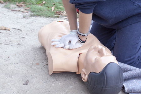 cardiopulmonary: Paramedic practicing Cardiopulmonary resuscitation - CPR on a dummy Stock Photo