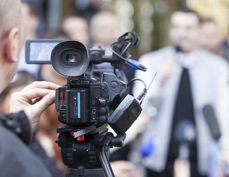 Media scrum. Impromptu press conference.