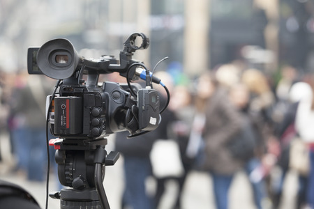 TV broadcasting. Media coverage of an event.