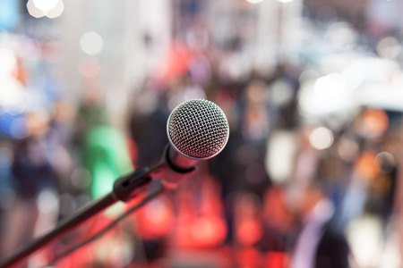 oration: Microphone in focus against blurred background